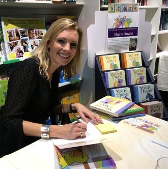 Me, happy as a pig in mud, signing my books - yey!